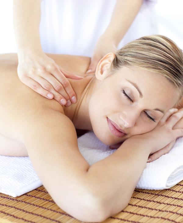 Positive woman having a back massag